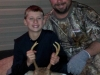 Second generation cousin Jace with his first buck, nice 4 point, and proud papa Chad